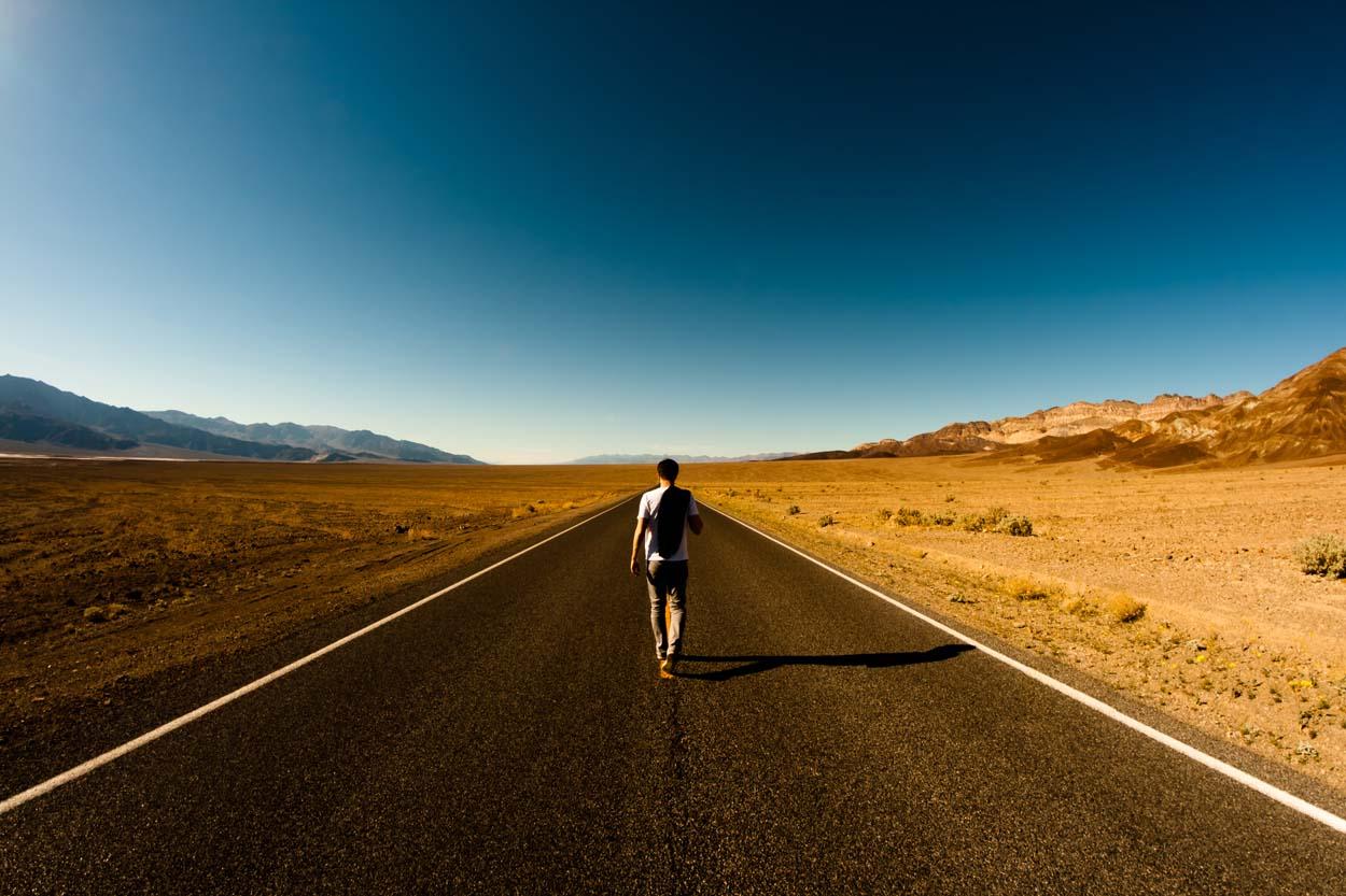 man walking on dessert highway